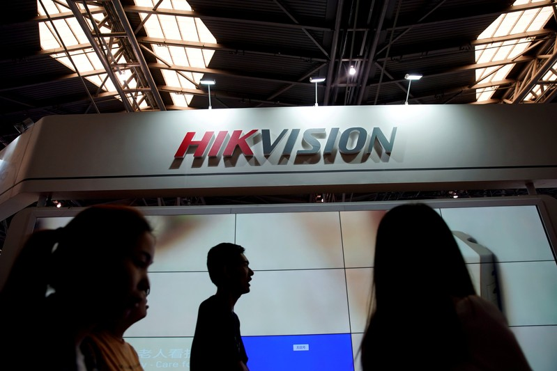 FILE PHOTO: People visit a Hikvision booth at a security exhibition in Shanghai
