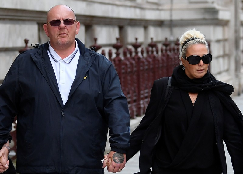Tim Dunn and Charlotte Charles, parents of Harry Dunn, leave the Foreign and Commonwealth office in London
