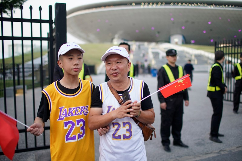 Fans in LeBron James jerseys hold Chinese flags outside the Mercedes-Benz Arena before the NBA exhibition game between Brooklyn Nets and Los Angeles Lakers in Shanghai