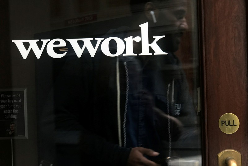 FILE PHOTO: A man walks out of a WeWork space in the Manhattan borough of New York City