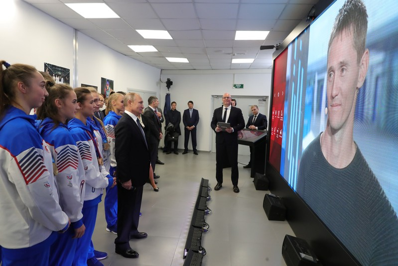 Russian President Vladimir Putin attends a teleconference on Match! television channel during the sport forum in Nizhny Novgorod