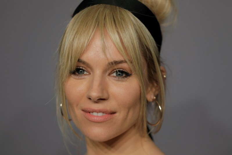 FILE PHOTO: Actor Sienna Miller arrives for an amfAR gala to celebrate Lee Daniels during New York Fashion Week in New York