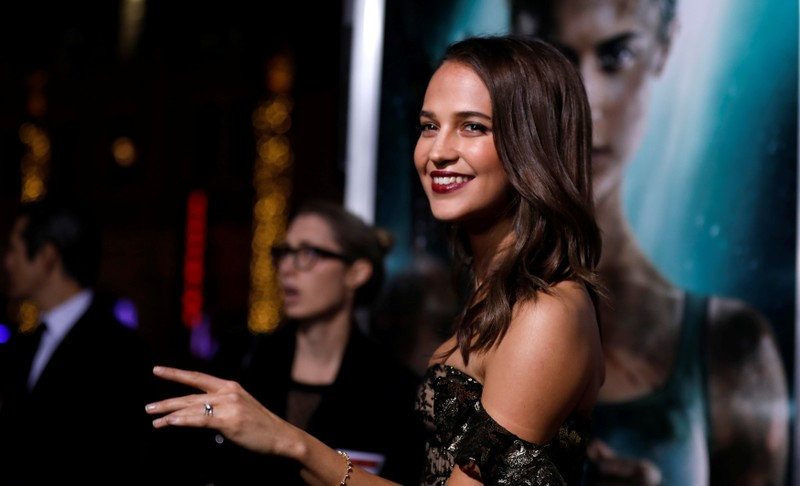 Cast member Vikander poses at the premiere for