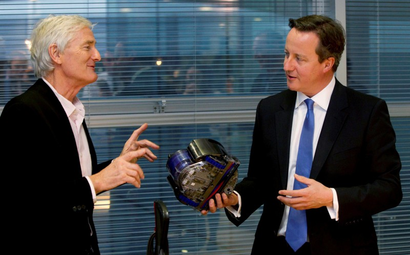 FILE PHOTO: Britain's Prime Minister Cameron views vacuum design products with Dyson at the Dyson headquarters in Malmesbury , south west England