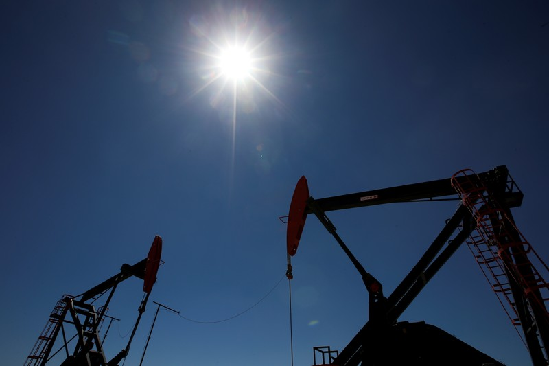 Oil rigs are seen at Vaca Muerta shale oil and gas drilling, in the Patagonian province of Neuquen