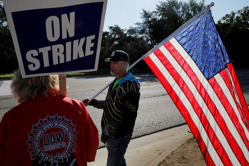 UAW workers march in Detroit as GM strike enters 26th day