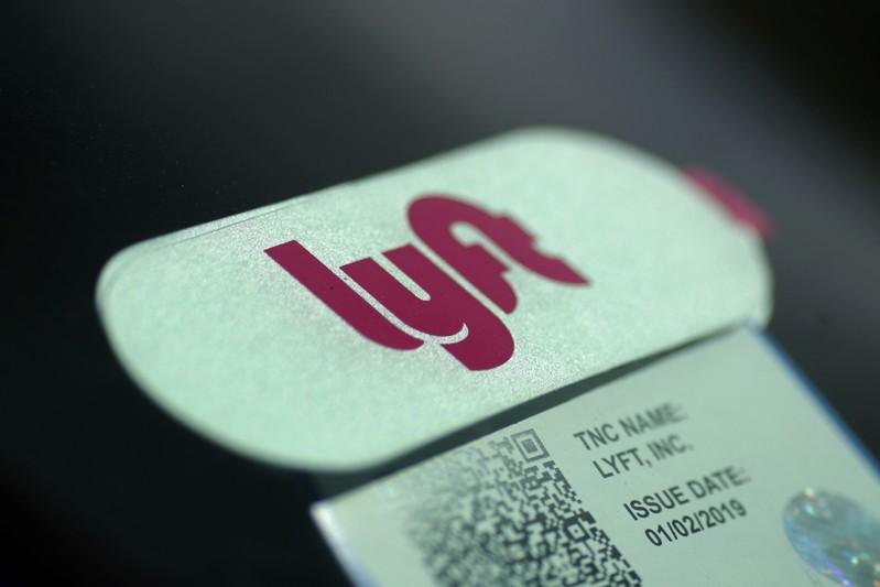 FILE PHOTO: A Lyft sticker is seen in a car windscreen in Los Angeles