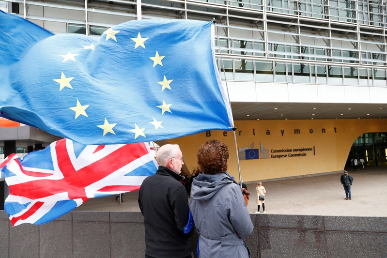 FILE PHOTO: Anti-Brexit protesters hold British and European Union flags outside the EU Commission headquarters in Brussels