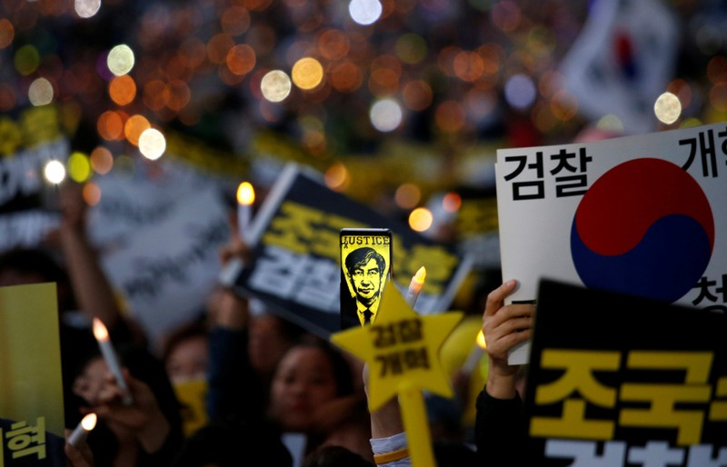 People take part in a protest to support Justice Minister Cho Kuk and to demand a prosecution reform in front of Seoul Central District Prosecutors' Office in Seoul
