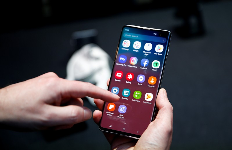 FILE PHOTO: A journalist uses the new Samsung Galaxy S10 smartphone at a press event in London