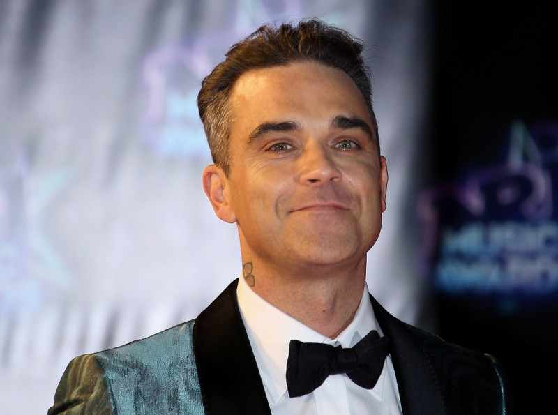 Singer Robbie Williams arrives to attend the NRJ Music Awards ceremony at the Festival Palace in Cannes