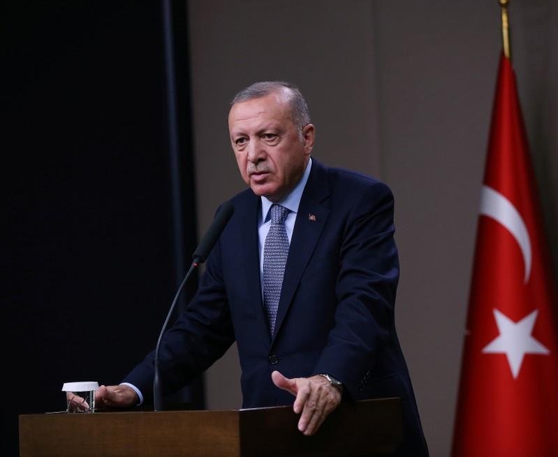 Turkish President Erdogan talks during a news conference at Esenboga International Airport in Ankara