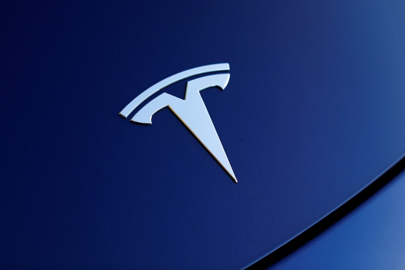 FILE PHOTO: The front hood logo on a 2018 Tesla Model 3 electric vehicle is shown in Cardiff, California