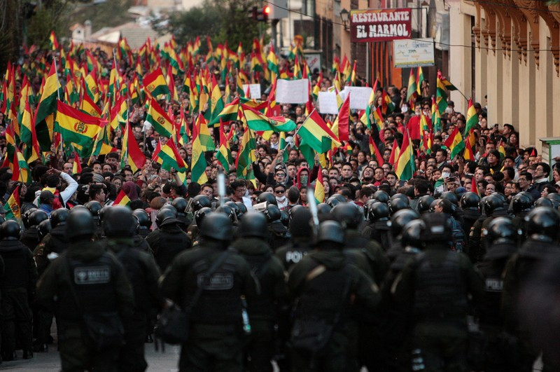 Bolivians banged on pots and pans from windows and rooftops in the capital La Paz on Friday, protesting a controversial election count handing President Evo Morales a fourth consecutive term that would extend his rule to nearly two decades.