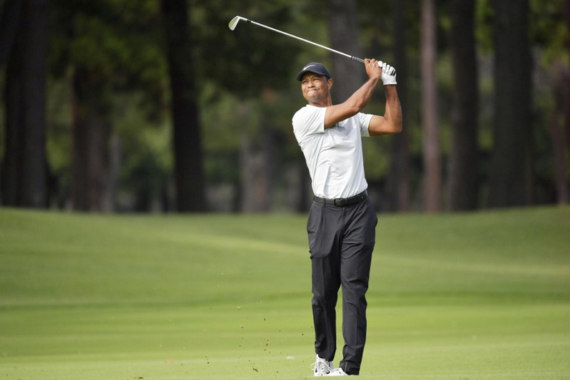 Woods shoots 64 in PGA's 1st tournament in Japan