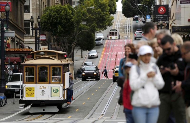 Passengers await a cable car near Union Square in San Francisco