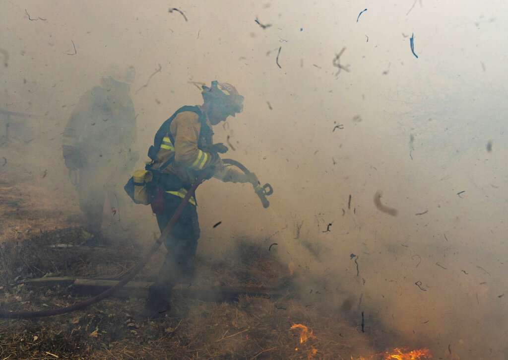 California wildfires: new blaze erupts as strong winds spread