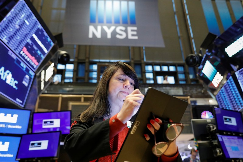 FILE PHOTO: A trader works on the floor at the NYSE in New York