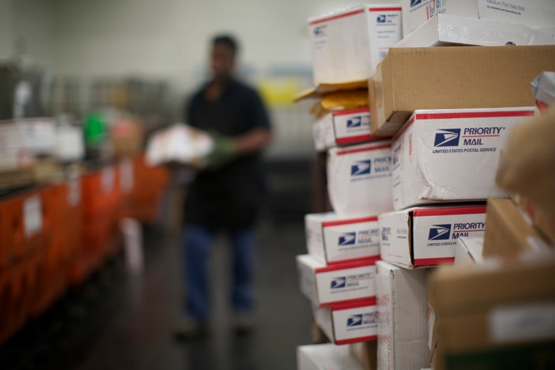 FILE PHOTO: United States Postal Service clerks sort mail at the USPS Lincoln Park carriers annex in Chicago
