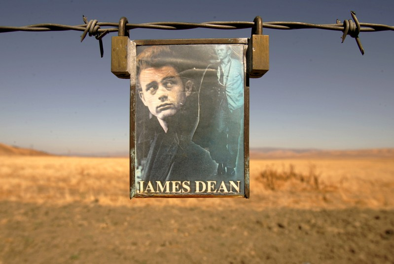 FILE PHOTO: A portrait of U.S. actor James Dean hangs from a fence near the intersection of Highways 46 and 41 n..