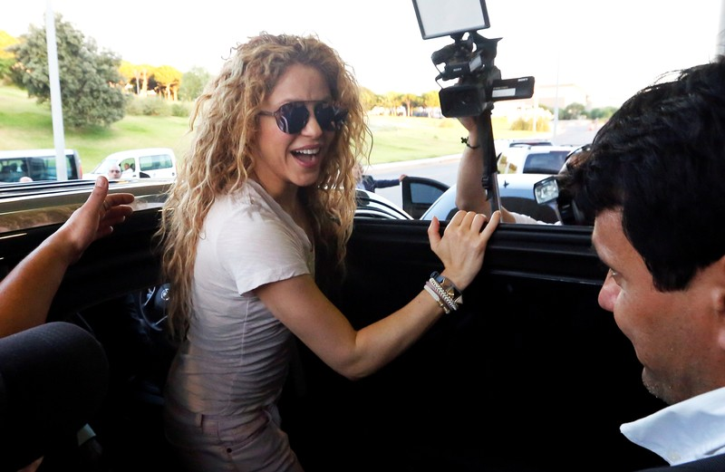 FILE PHOTO - Colombian singer Shakira reacts upon her arrival with her kids at the airport in Beirut