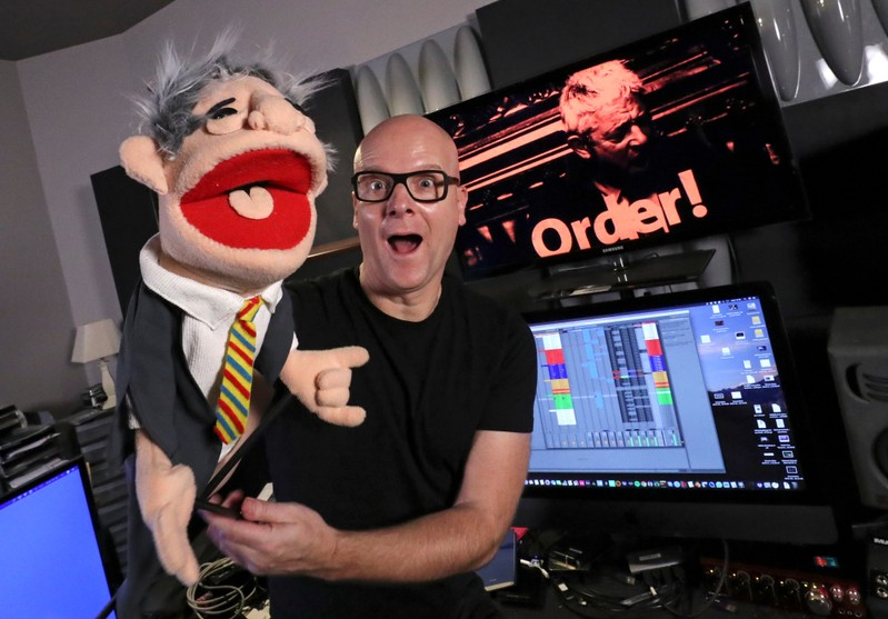 Belgian music producer Michael Schack poses with a puppet depicting John Bercow in Antwerp