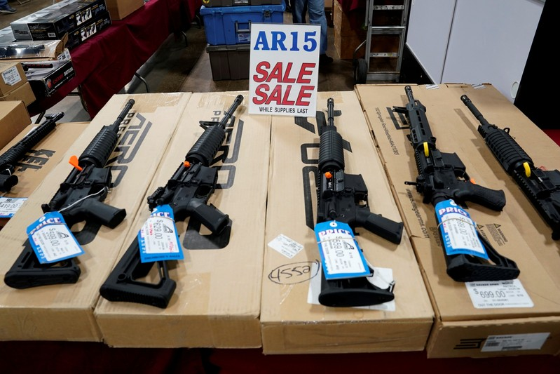 FILE PHOTO: AR-15 rifles are displayed for sale at the Guntoberfest gun show in Oaks, Pennsylvania