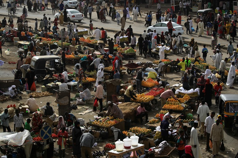 Sudanese residents shop in a bazaar in Khartoum