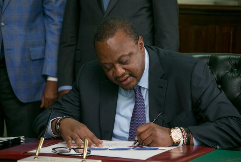 FILE PHOTO:  Kenya's President Uhuru Kenyatta signs into law the Finance Bill 2019 at State House in Nairobi