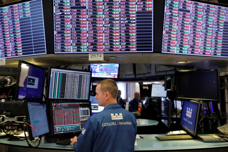 A trader works on the trading floor at the New York Stock Exchange (NYSE) in New York City