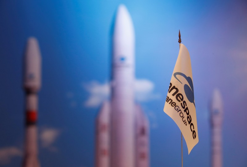 FILE PHOTO: A flag with a company logo is seen during satellite launch company Arianespace annual news conference in Paris