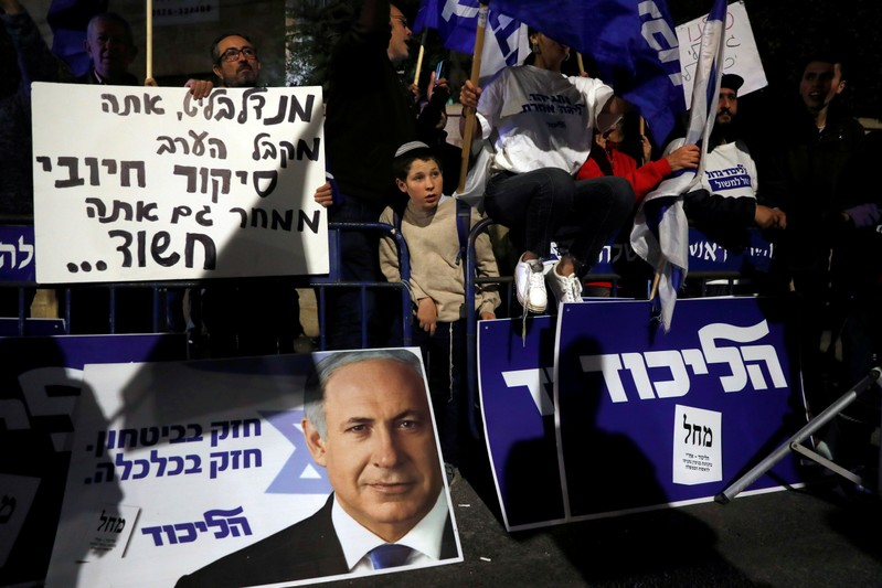 FILE PHOTO: Supporters of Israeli Prime Minister Benjamin Netanyahu protest outside his residence following Israel's Attorney General Avichai Mandelblit's indictment ruling in Jerusalem