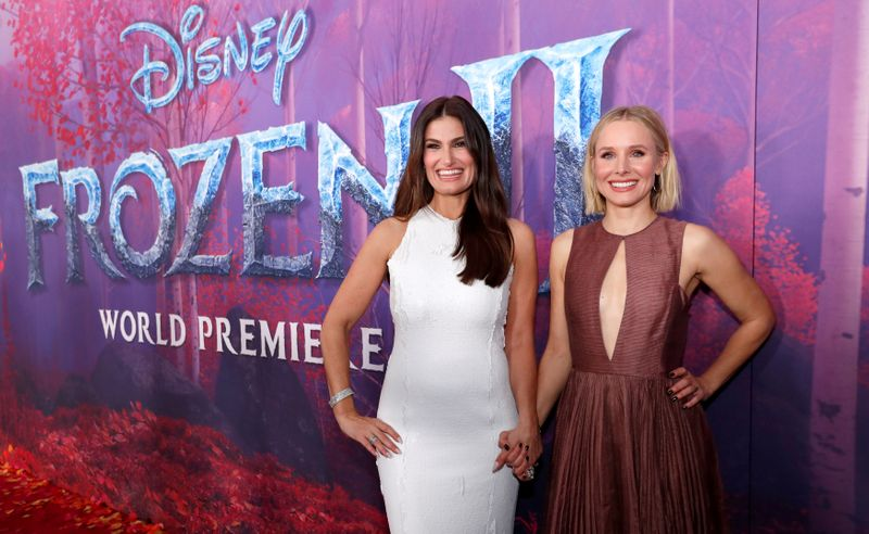 FILE PHOTO: Cast members Menzel and Bell pose at the premiere for the film
