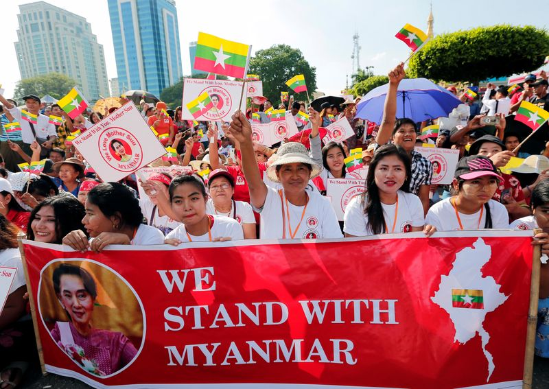 People gather to rally in support of Myanmar State Counsellor Aung San Suu Kyi before she heads off to the International Court of Justice (ICJ), in Yangon
