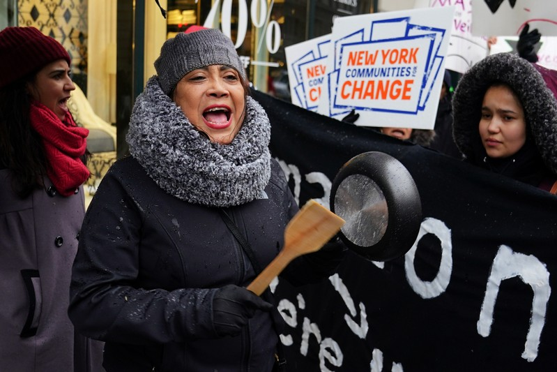 A woman takes part in a rally against Amazon and their business practices in the Manhattan borough of New York City
