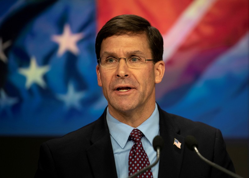 FILE PHOTO: U.S. Defense Secretary Mark T. Esper delivers remarks before ringing the closing NASDAQ bell in New York