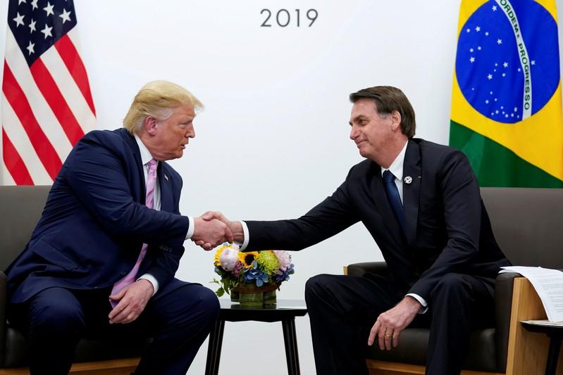 FILE PHOTO: U.S. President Trump and Brazil's Bolsonaro at G20 summit in Osaka in June