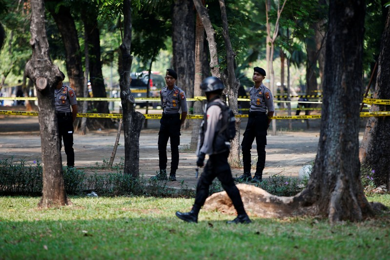 Indonesian police officers stand guard following a blast at National Monument (Monas) complex in Jakarta