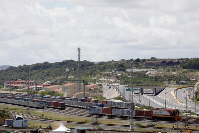 An SGR cargo train transferring containers leaves the port of Mombasa