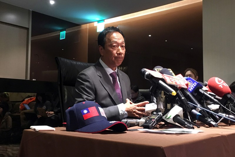 Foxconn Technology Group founder Terry Gou attends a news conference before leaving for the United States, at Taipei Songshan Airport
