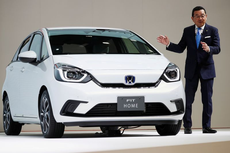 FILE PHOTO: Honda's President and CEO Takahiro Hachigo shows the new Honda Fit during the Tokyo Motor Show, in Tokyo