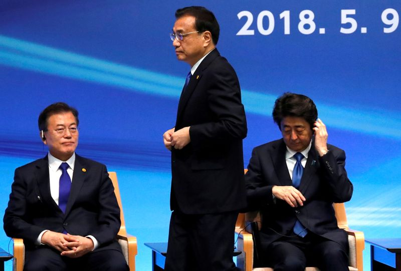 China hosts Japan and South Korea as regional tensions simmer