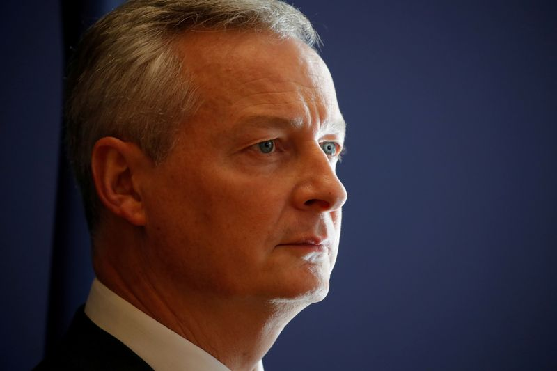 FILE PHOTO: French Finance Minister Bruno Le Maire attends a news conference at the Finance Ministry in Paris