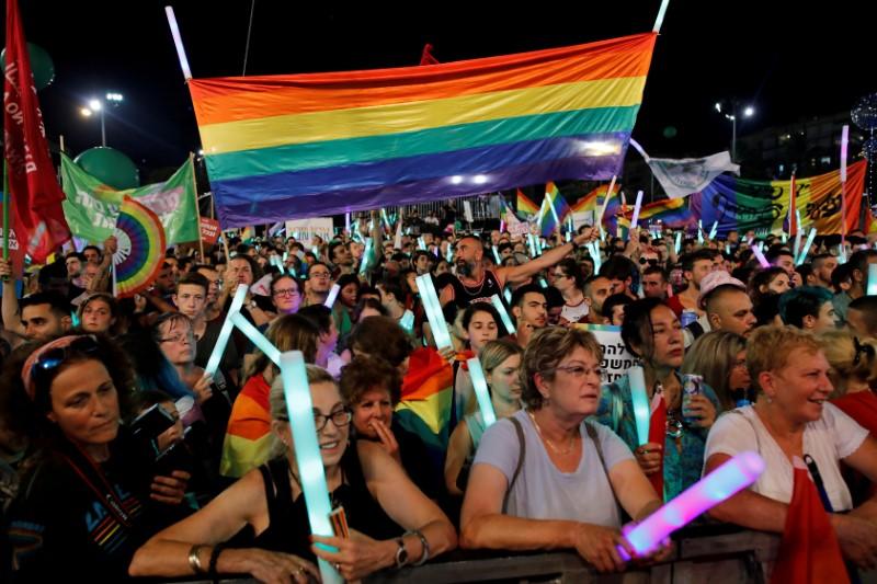 FILE PHOTO: Protesters take part in a LGBT community members protest against discriminatory surrogate bill in Rabin Square in Tel Aviv
