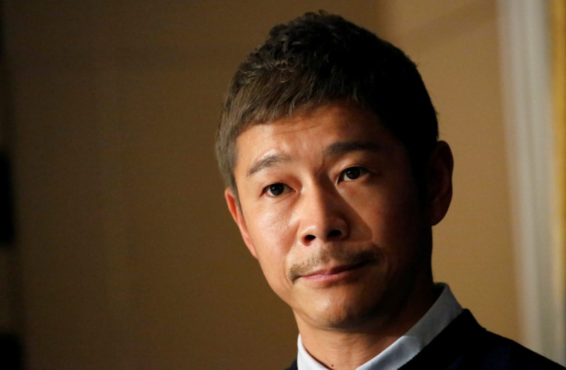FILE PHOTO: Japanese billionaire Yusaku Maezawa, founder and chief executive of online fashion retailer Zozo, who has been chosen as the first private passenger by SpaceX, attends a news conference at the Foreign Correspondents' Club of Japan in Tokyo
