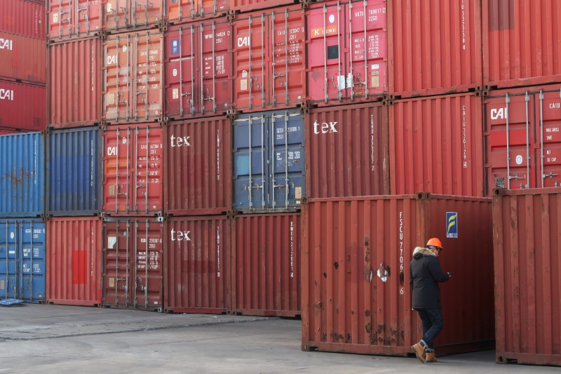 Worker checks containers at a logistics center near Tianjin port