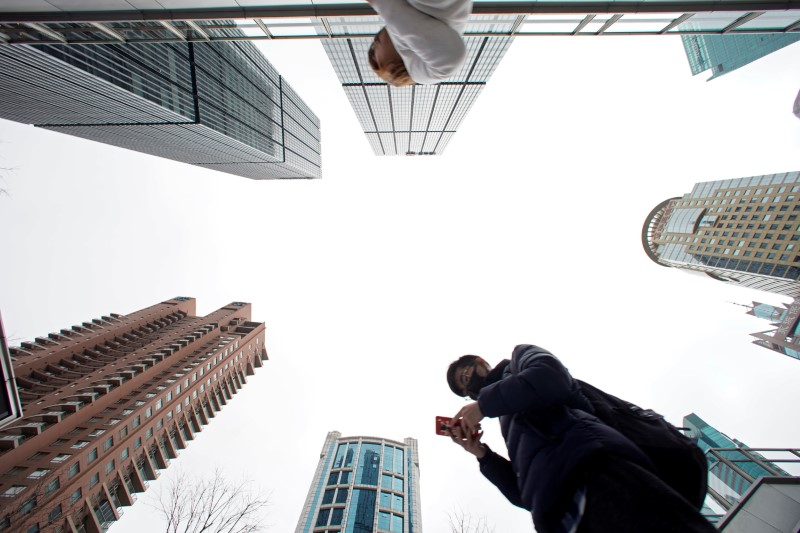 A man checks phone at Lujiazui financial district in Pudong
