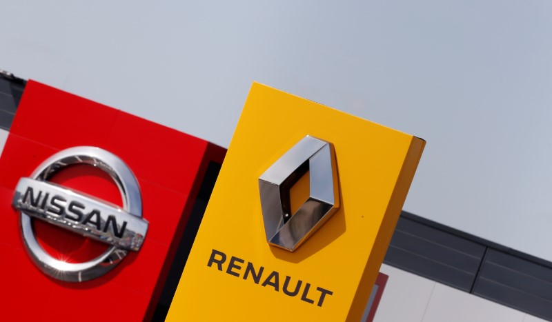 The logos of car manufacturers Renault and Nissan are seen in front of dealerships of the companies in Reims