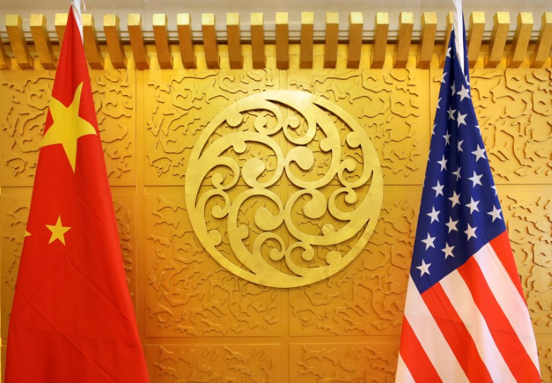 Chinese and U.S. flags are set up for a meeting during a visit by U.S. Secretary of Transportation Elaine Chao at China's Ministry of Transport in Beijing