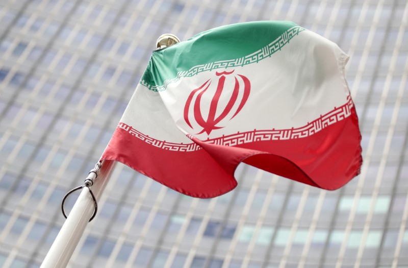 FILE PHOTO: The Iranian flag flutters in front the International Atomic Energy Agency headquarters in Vienna